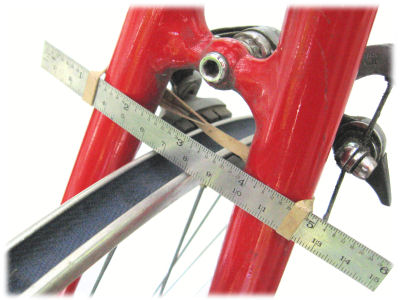 Truing a wheel in the bicycle frame using a ruler