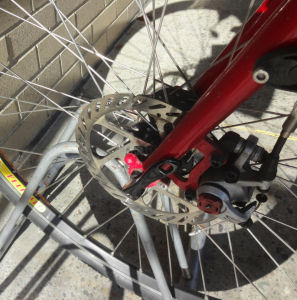 Disk brake interference with bike rack, photo by Hal Chamberlin