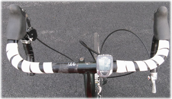 Handlebars with tape holding brake cable