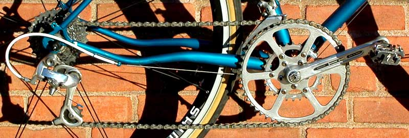 a wide-step system using a racing derailer